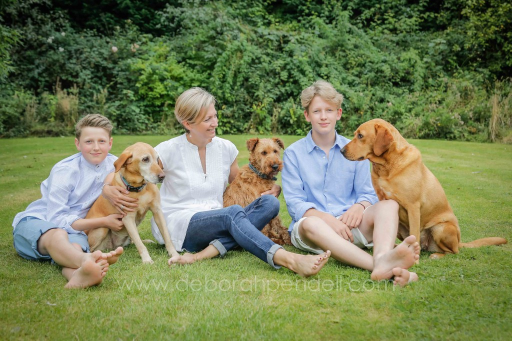 family portrait photography outdoors with dogs