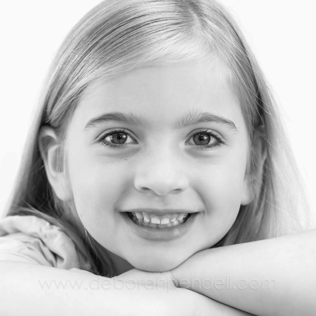 black and white portrait photograph of a young girl