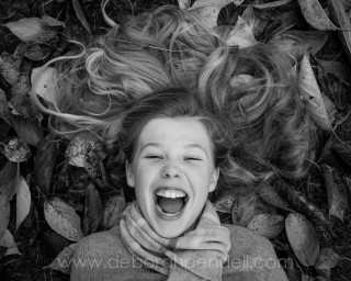 Outdoor portrait photo of girl laughing